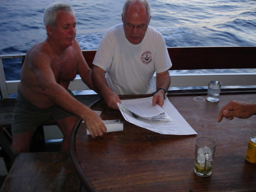 Kevin and Dieter pooring over their research trying to find the wrecks -aided as always by copiuos amounts of G&T