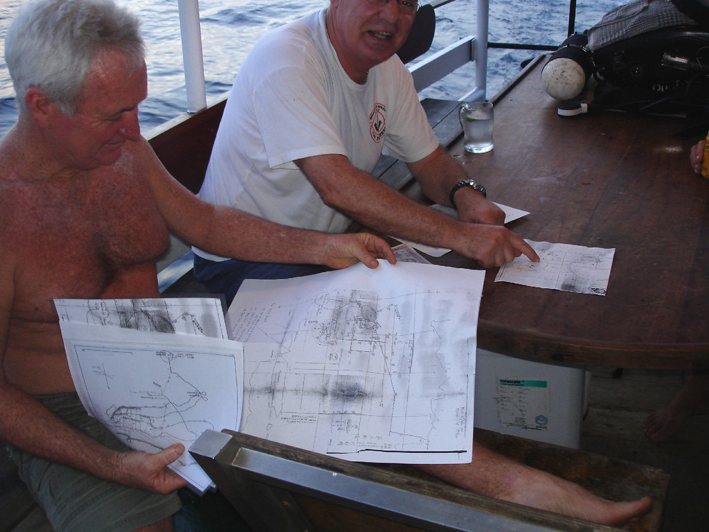 Kevin and Dieter pooring over their research trying to find the wrecks