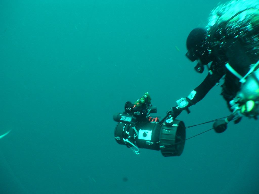 Hori-san making his way down to the wreck to place a memorial