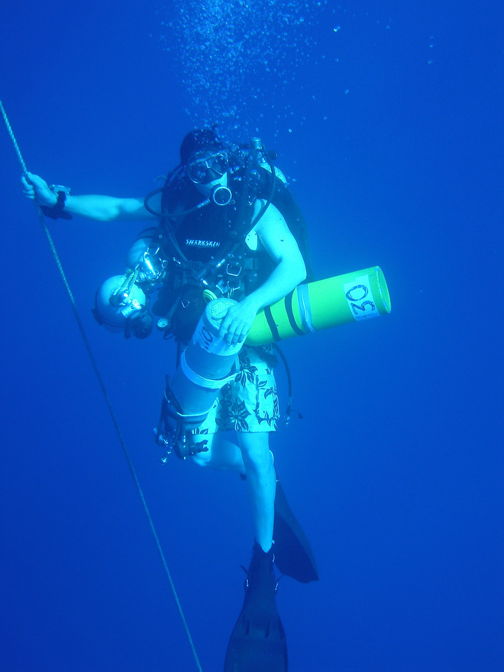 Mike retrieving deep bail gas tanks from bottom divers