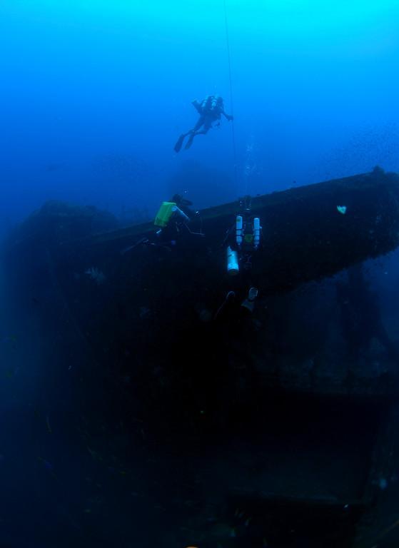 Divers ascending up port side bridge wing