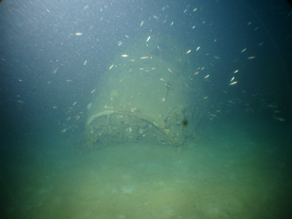 Nose of the plane buried in sand