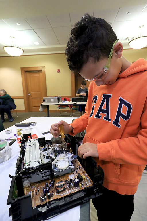 . The Leominster Library University Jr. program held a Wreck the Tech program on Saturday, January 12, 2019. During this tech take apart party, kids where able to explore and take apart keyboards, desk phones, VCRs, one small Herbie VW bug & more! This is a great opportunity to figure out how things are put together and how they work. Michael kelley, 11, takes apart a VCR player during the program. SENTINEL & ENTERPRISE/JOHN LOVE