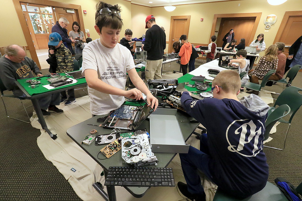 . The Leominster Library University Jr. program held a Wreck the Tech program on Saturday, January 12, 2019. During this tech take apart party, kids where able to explore and take apart keyboards, desk phones, VCRs, one small Herbie VW bug & more! This is a great opportunity to figure out how things are put together and how they work. Ethan Mallinson, 12, and Diesel Whotten, 12, work on taking some items apart during the program. SENTINEL & ENTERPRISE/JOHN LOVE