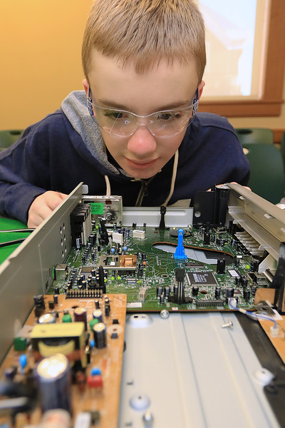 The Leominster Library University Jr. program held a Wreck the Tech program on Saturday, January 12, 2019. During this tech take apart party, kids where able to explore and take apart keyboards, desk phones, VCRs, one small Herbie VW bug & more! This is a great opportunity to figure out how things are put together and how they work. Diesel Whitten, 12, looka over the inner parts of an old DVD and VHS machine during the program. SENTINEL & ENTERPRISE/JOHN LOVE