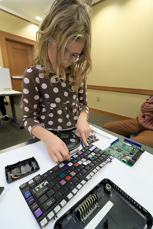 . The Leominster Library University Jr. program held a Wreck the Tech program on Saturday, January 12, 2019. During this tech take apart party, kids where able to explore and take apart keyboards, desk phones, VCRs, one small Herbie VW bug & more! This is a great opportunity to figure out how things are put together and how they work. Natalie Guilmette, 8, takes aprt the keyboard from a laptop during the program. SENTINEL & ENTERPRISE/JOHN LOVE