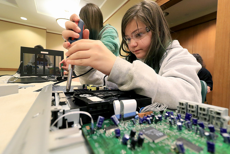 The Leominster Library University Jr. program held a Wreck the Tech program on Saturday, January 12, 2019. During this tech take apart party, kids where able to explore and take apart keyboards, desk phones, VCRs, one small Herbie VW bug & more! This is a great opportunity to figure out how things are put together and how they work. Mia Puglisi, 12, talks apart a DVD player during the program. SENTINEL & ENTERPRISE/JOHN LOVE