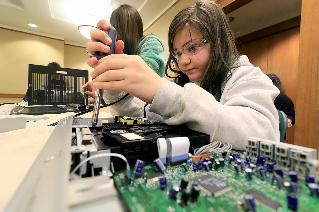 . The Leominster Library University Jr. program held a Wreck the Tech program on Saturday, January 12, 2019. During this tech take apart party, kids where able to explore and take apart keyboards, desk phones, VCRs, one small Herbie VW bug & more! This is a great opportunity to figure out how things are put together and how they work. Mia Puglisi, 12, talks apart a DVD player during the program. SENTINEL & ENTERPRISE/JOHN LOVE