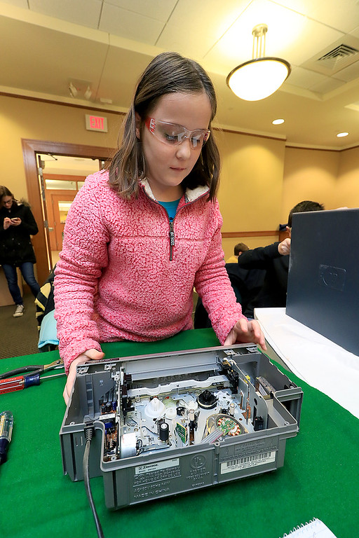 . The Leominster Library University Jr. program held a Wreck the Tech program on Saturday, January 12, 2019. During this tech take apart party, kids where able to explore and take apart keyboards, desk phones, VCRs, one small Herbie VW bug & more! This is a great opportunity to figure out how things are put together and how they work. Sarah Peterson, 11, takes apart an old VHS machine during the program. SENTINEL & ENTERPRISE/JOHN LOVE