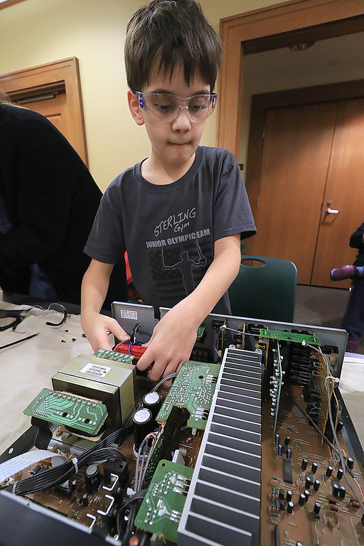 . The Leominster Library University Jr. program held a Wreck the Tech program on Saturday, January 12, 2019. During this tech take apart party, kids where able to explore and take apart keyboards, desk phones, VCRs, one small Herbie VW bug & more! This is a great opportunity to figure out how things are put together and how they work. Luca Puglisi, 10, takes apart an old computer during the program. SENTINEL & ENTERPRISE/JOHN LOVE