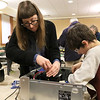 The Leominster Library University Jr. program held a Wreck the Tech program on Saturday, January 12, 2019. During this tech take apart party, kids where able to explore and take apart keyboards, desk phones, VCRs, one small Herbie VW bug & more! This is a great opportunity to figure out how things are put together and how they work. Chase Pratt, 10, gets some help, taking apart an old computer, from the Libraries Technology Librarian Brittany Recker during the program. SENTINEL & ENTERPRISE/JOHN LOVE
