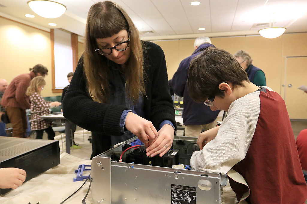 . The Leominster Library University Jr. program held a Wreck the Tech program on Saturday, January 12, 2019. During this tech take apart party, kids where able to explore and take apart keyboards, desk phones, VCRs, one small Herbie VW bug & more! This is a great opportunity to figure out how things are put together and how they work. Chase Pratt, 10, gets some help, taking apart an old computer, from the Libraries Technology Librarian Brittany Recker during the program. SENTINEL & ENTERPRISE/JOHN LOVE