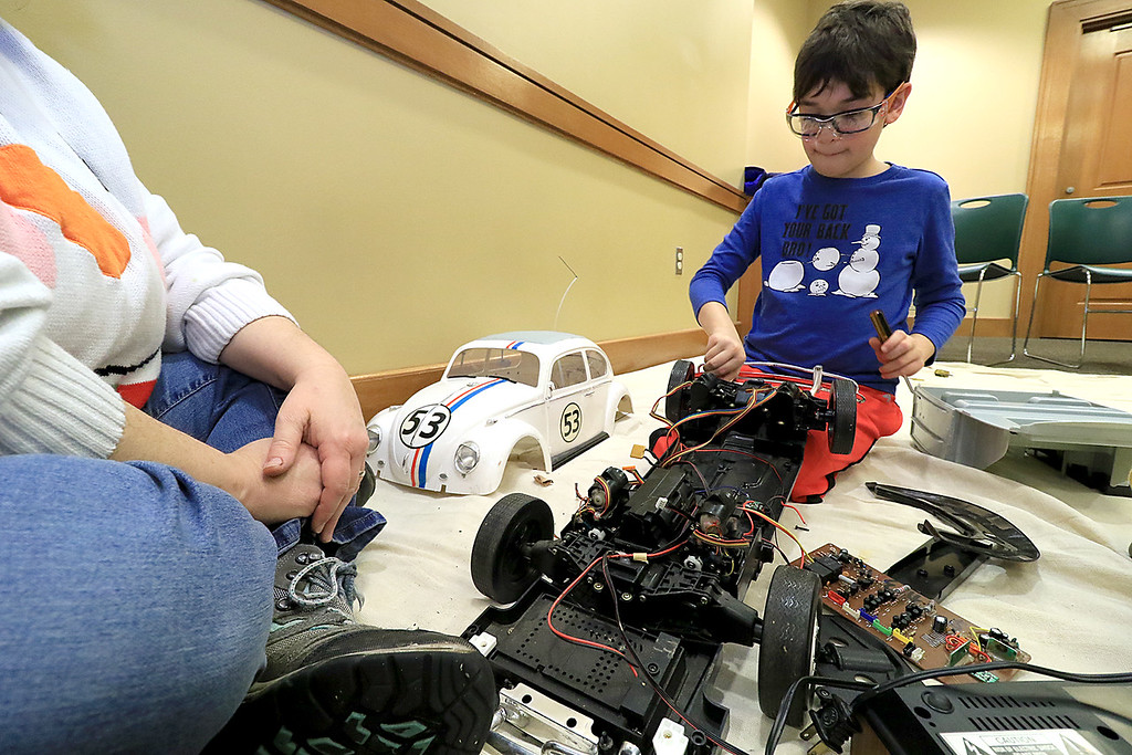 . The Leominster Library University Jr. program held a Wreck the Tech program on Saturday, January 12, 2019. During this tech take apart party, kids where able to explore and take apart keyboards, desk phones, VCRs, one small Herbie VW bug & more! This is a great opportunity to figure out how things are put together and how they work. Ilan Cohen, 9, takes apart a broken Jerbie VW Bug during the program. SENTINEL & ENTERPRISE/JOHN LOVE