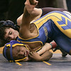 (Saturday February 9th 2014 - Warren Fitzgerald High School - Athletic Gym - Warren, MI) Sam Tomlinson of Berkley High School (behind) grapples with a Redford Union opponent Saturday at the MHSAA wrestling Disctrics at Warren Fitzgerald High School. Photo by: Brian B. Sevald