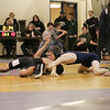 (Saturday February 9th 2014 - Warren Fitzgerald High School - Athletic Gym - Warren, MI) Aaron Stepp (right) of Warren Fitzgerald High School attempts to roll over his opponent for a pin Saturday at the MHSAA wrestling Disctrics at Warren Fitzgerald High School. Photo by: Brian B. Sevald