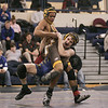 (Saturday February 9th 2014 - Warren Fitzgerald High School - Athletic Gym - Warren, MI) Josh Young (standing upright) of Ferndale High School attempts to avoid a takedown by an opponent Saturday at the MHSAA wrestling Disctrics at Warren Fitzgerald High School. Photo by: Brian B. Sevald