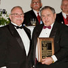 Jerry Wager accepts from Alan Rice 8Y2T1097