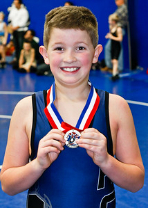 Aaron pinned each of his oppenents to earn first place in the Midget 92-lb class.