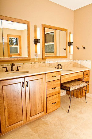 Tamo project:  Tasteful bath has universal design features of a  roll in shower with handheld spray and seating.  There's seating available at the vanity as well.      www.wrightbuilt.biz