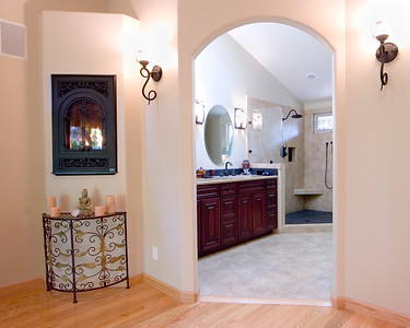 Petronave project:  Complete master suite remodel involved vaulted the flat ceilings, building an accessible walk in shower, built in fireplace and much more.   www.wrightbuilt.biz