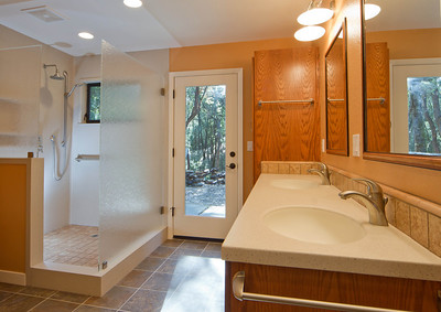 Mason project:  Accessible shower using Swanstone walls for easy maintenance.   Open shower design with low threshold, grab bars and a seat provides easy and safe bathing for everyone.    www.wrightbuilt.biz