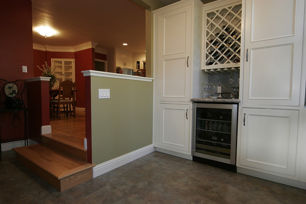 """Grass Valley Victorian:<br /> <br /> Painted cabinets, crown moulding and hardwood floors are part of this complex remodel.   The laundry was converted into pantry / wine bar.  We removed walls to open up the two spaces.<br /> <br />  <a href=""""http://www.wrightbuilt.biz"""">http://www.wrightbuilt.biz</a>  <a href=""""http://www.wrightbuilt.biz"""">http://www.wrightbuilt.biz</a>"""