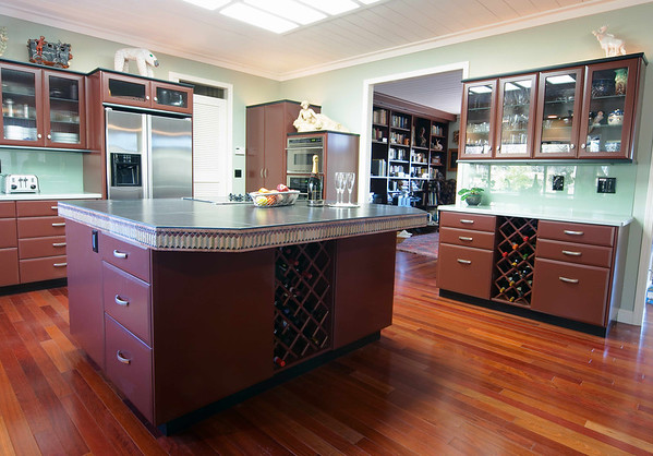 """Cabinets painted the color of manzanita bark with mint green corian counters and glass backsplash make a unique statement in this art lovers home.<br /> <br />   <a href=""""http://www.wrightbuilt.biz"""">http://www.wrightbuilt.biz</a>"""