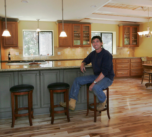 """Lead Carpenter Ron Moser at completion of Vanwagner remodel.  We removed bearing walls to open up the kitchen and create the oversized island.  Jay Rambo cabinets, Caesarstone counters and hickory flooring were used.<br /> <br />   <a href=""""http://www.wrightbuilt.biz"""">http://www.wrightbuilt.biz</a>"""