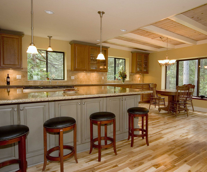 """Vanwagner remodel:<br />   We removed bearing walls to open up the kitchen and create the oversized island.  Jay Rambo cabinets, Caesarstone counters and hickory flooring were used.<br /> <br />   <a href=""""http://www.wrightbuilt.biz"""">http://www.wrightbuilt.biz</a>"""