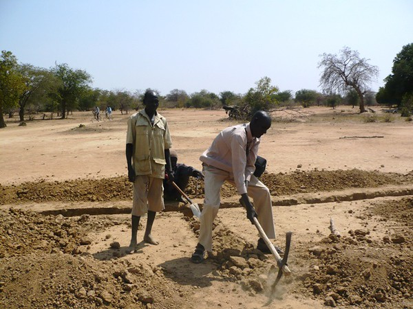 Our field manager Yel Maduok Ngor helps to dig the foundation trench for our school.