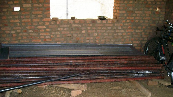 We also stored the corrugated iron sheeting for the roof and iron bars inside.