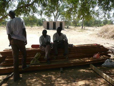 They worked in the shade. Our new latrines are in the background.