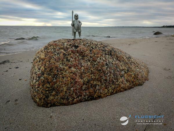 September 2019: Climbing a rock on the shores of Lumsas, Denmark
