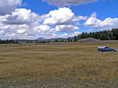 """OK.  Remember the sign that said """"Big Sandy Opening?""""  This is it : )  A very large set of meadows/prairies up in the mountains.  My truck is headed the wrong direction, but the camera is pointed towards the campground (several miles away) and the mountains that I'll be taking the trails into."""