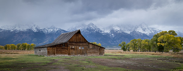 T.A. Moulton barn on Mormon row near Moose Junction.  The barn was originally built in 1913 and is the most photographed barn in America.  The Teton mountains are in the background.