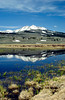 A small pond and the Gallatin mountains in the Indian Creek region of Yellowstone National Park, Wyoming, USA.