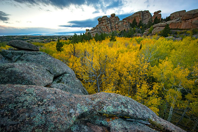 Fall colors of aspen trees in the Blair-Wallis area of Veduawoo in Albany County, Wyoming. The unique rock formations outside of Laramie provide for a popular rock climbing and hiking destination.   Photo by Kyle Spradley | © Kyle Spradley Photography | www.kspradleyphoto.com