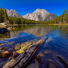 "Leigh Lake during early fall season in Grand Teton National Park. The Teton Range is reflected into the clear, mountain lake on a clear, blue sky and sunny day.<br /> <br /> © Kyle Spradley Photography |  <a href=""http://www.kspradleyphoto.com"">http://www.kspradleyphoto.com</a>"
