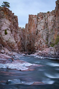 Fremont Canyon along the North Platte River in central Wyoming. The sheer cliffs drop 200 ft in most spots to the picturesque clear waterway as it meanders through the landscape of Natrona County.  Photo by Kyle Spradley | © Kyle Spradley Photography | www.kspradleyphoto.com