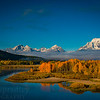 "A fall sunrise at the infamous Oxbox Bend in Grand Teton National Park. The peaks of the Teton Range rise above the Snake River that meanders past golden canopies of cottonwoods and aspens just below Jackson Lake.  <br /> <br /> © Kyle Spradley Photography |  <a href=""http://www.kspradleyphoto.com"">http://www.kspradleyphoto.com</a>"