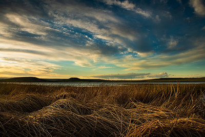 Spring sunset at Twin Buttes Lake, outside of Laramie, Wyoming. The reservoir is one of the Plains Lakes in Albany County known for its great fishery, scenic views and destination for outdoor enthusiasts.   Photo by Kyle Spradley | © Kyle Spradley Photography | www.kspradleyphoto.com