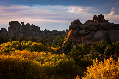 A late summer sunset viewed at Vedauwoo in the Medicine Bow-Routt National Forest outside of Laramie, Wyoming. With the aspens in fall color, the landscape lights up in the evening light.  Photo by Kyle Spradley | © Kyle Spradley Photography | www.kspradleyphoto.com