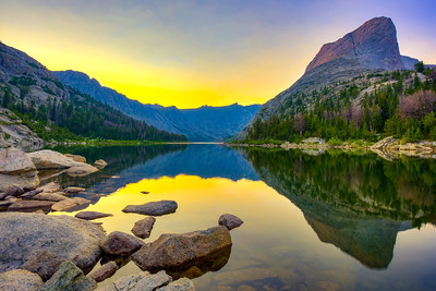 A high altitude sunrise during the summer at Black Joe Lake in the Wind River Range of western Wyoming. The expansive lake is tucked below Haystack Mountain and is enclosed by mountain ridges on all sides.  Photo by Kyle Spradley | © Kyle Spradley Photography | www.kspradleyphoto.com