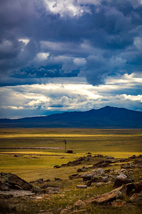 Thunderstorm clouds roll across the horizon of the plains outside of Laramie, Wyoming. Spring is a varied weather climate in southeastern Wyoming as big clouds roll across the wide landscapes.  Photo by Kyle Spradley | © Kyle Spradley Photography | www.kspradleyphoto.com