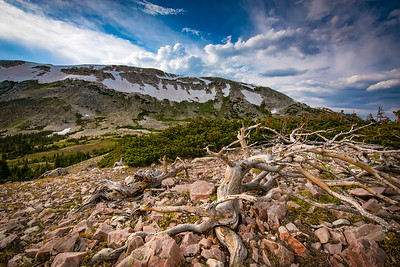 A summer afternoon in the Snowy Range Mountains. Views of the many alpine lakes can be seen from scenic vistas along the infamous Snowy Range Scenic Byway.   Photo by Kyle Spradley | © Kyle Spradley Photography | www.kspradleyphoto.com