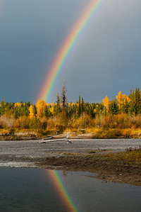 Grand Teton National Pasrk, rainbow over aspen/coniferous forest along Pacific Creek, Wyoming.