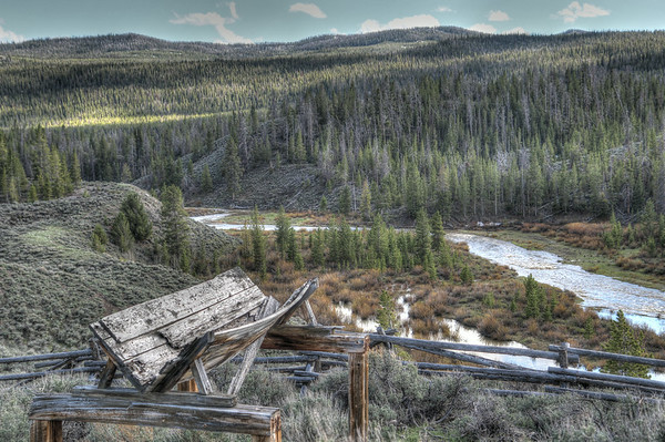 A section of an old mining trough stands as a lone reminder of ingenuity of a past era.  The Wind River is in the valley below and has cut its twist and turns over the years.