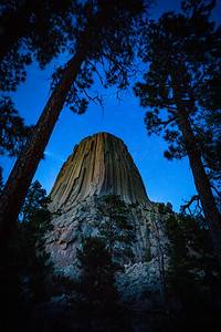 Stars shine above Devil's Tower National Monument during a summer evening.  Photo by Kyle Spradley | © Kyle Spradley Photography | www.kspradleyphoto.com