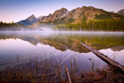 A foggy sunrise at String Lake in Grand Teton National Park lies at the base of the Teton Range and is a popular destination for kayakers.  © Kyle Spradley Photography | www.kspradleyphoto.com