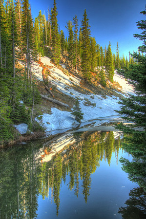 The pool sits on the continental divide in on the John D. Rockefeller Parkway  in Yellowstone NP.